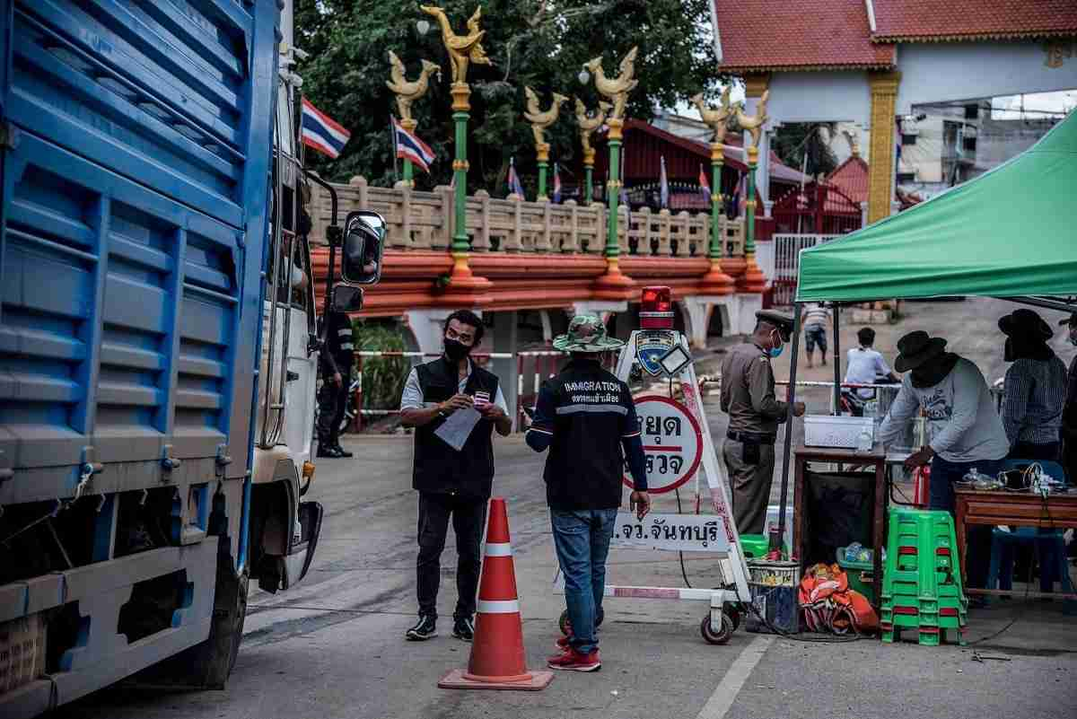 Immigration officer and volunteer at Baan Laem Checkpoint, Chanthaburi Province