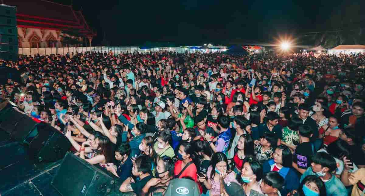 A huge crowd packs a outdoor concert in Krabi, shunning masks and social distancing.