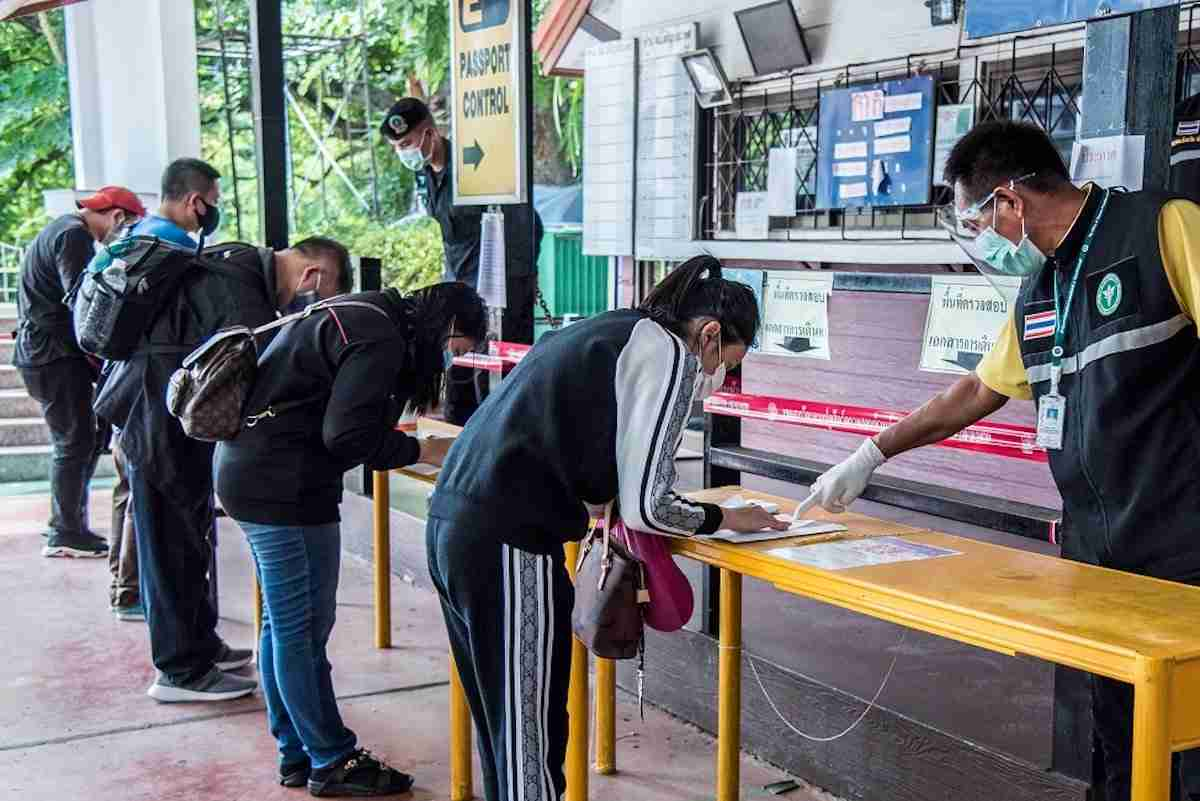 Travellers filling out forms at Sa Keow Border Checkpoint, Aryanaphrathet District