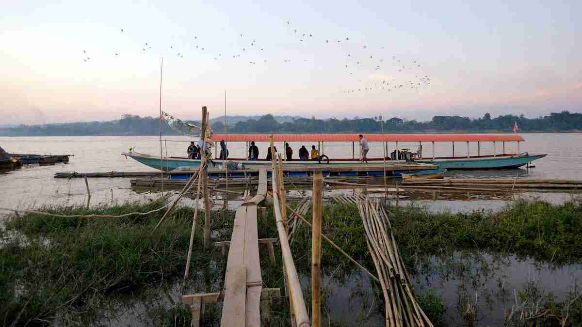 A ferry moored at the shore of the Mekong in Chiang Khan district, northeast Thailand, bordering Laos. (Photo: Eddie Gerald / Alamy)