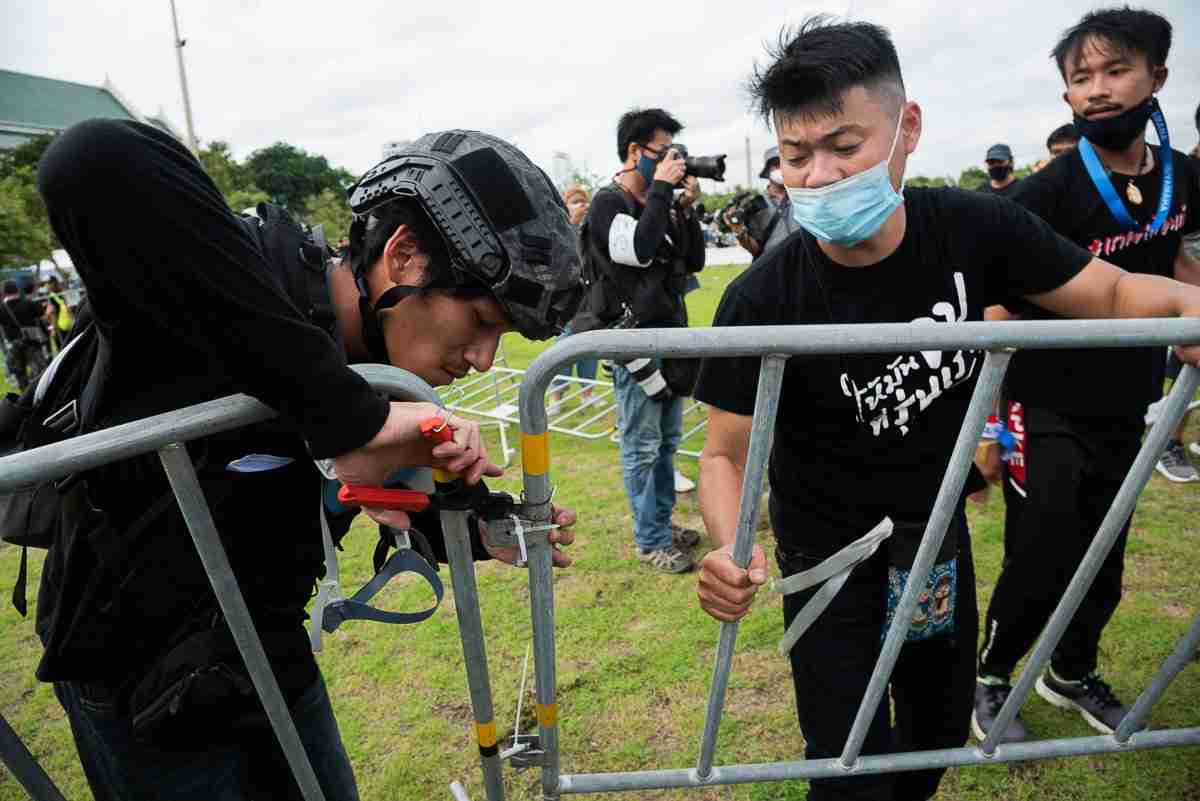 Demonstrators cut through barriers at Bangkok's Sanam Luang Sept. 19 to protest and demand sweeping democratic reforms. (Photo: Will Langston)