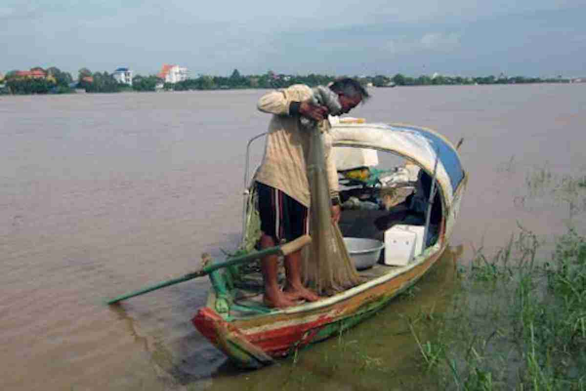 Climate change and dams have resulted in unpredictable wet and dry seasons and upset fish spawning patterns on the Mekong River. (Photo- UCA News)