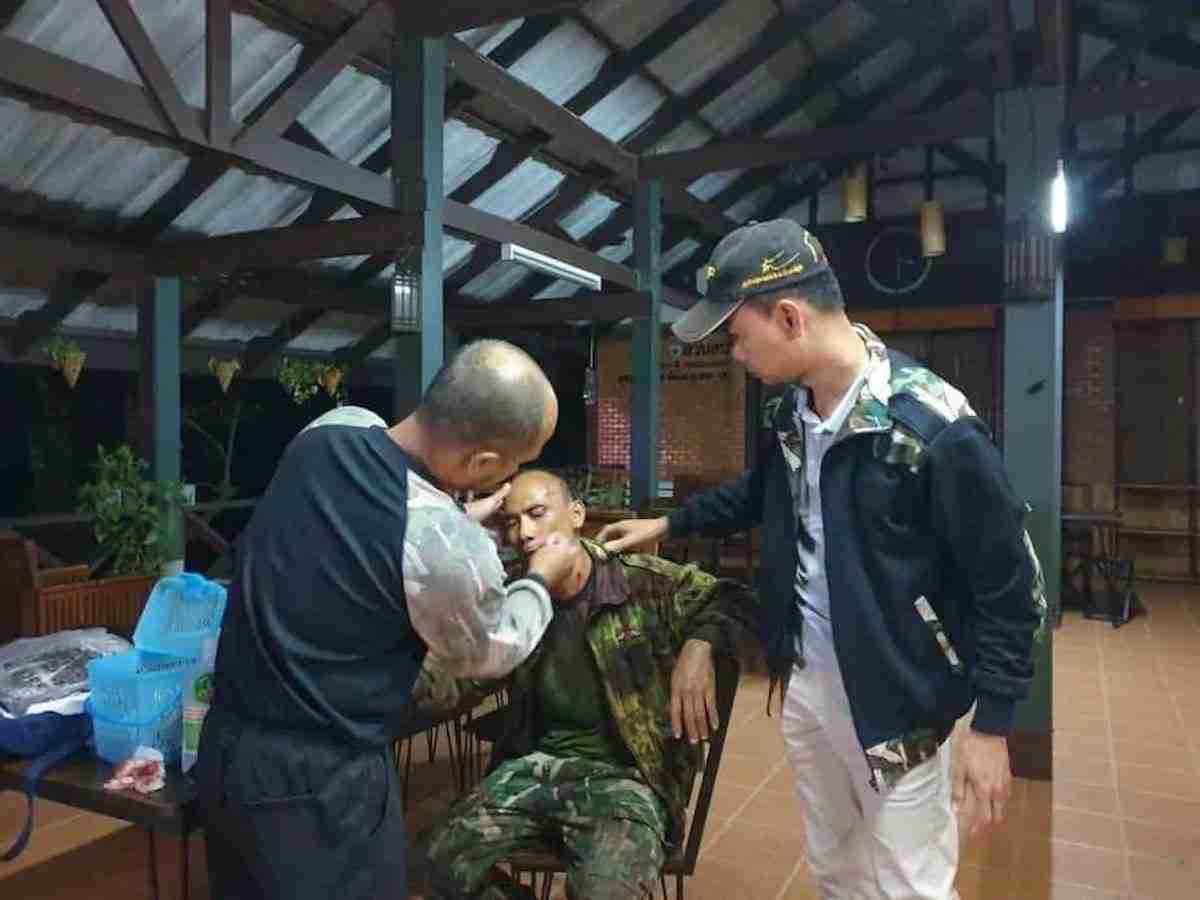 An injured Doi Suthep ranger is treated for stab wounds.
