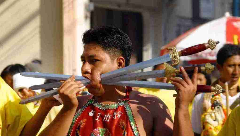 In addition to lots of food, the Phuket Vegetarian Festival is famous for is gruesome face piercing exhibitions.
