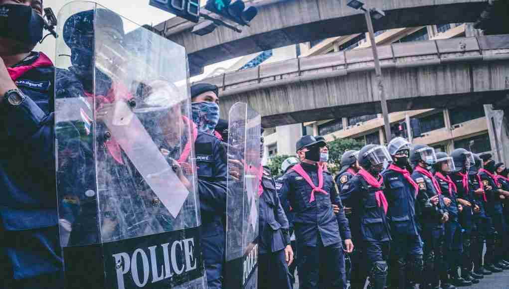 Riot police line up to disperse protestors at Bangkok's Ratchprasong intersection Oct. 15.