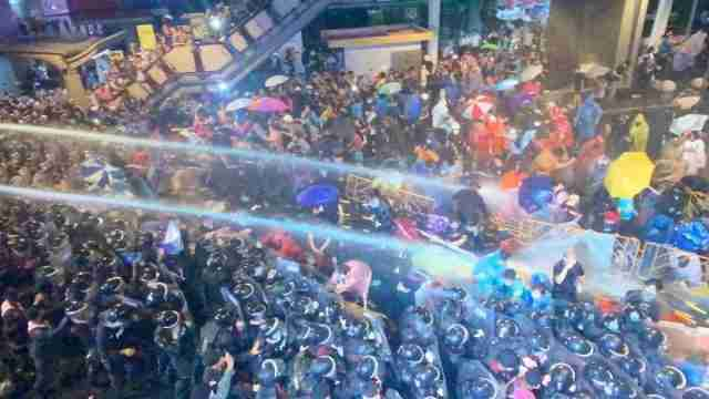 Riot police use water cannons on peaceful, unarmed students protestors in Bangkok Oct. 16.