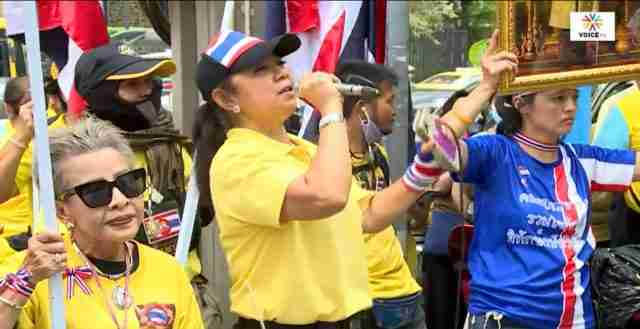 Members of the ultraroyalist Center for People Protecting the Monarchy protest Oct. 12 in front a Bangkok business owned by prominent progressive politician Thanathorn Juangroongruangkit in Bangkok.