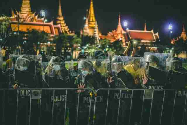 Police and yellow-shirted royalists form a line opposing pro-democracy protestors at a demonstration at Bangkok's Democracy Monument last week. (Photo: Tyler Roney for the Bangkok Herald)