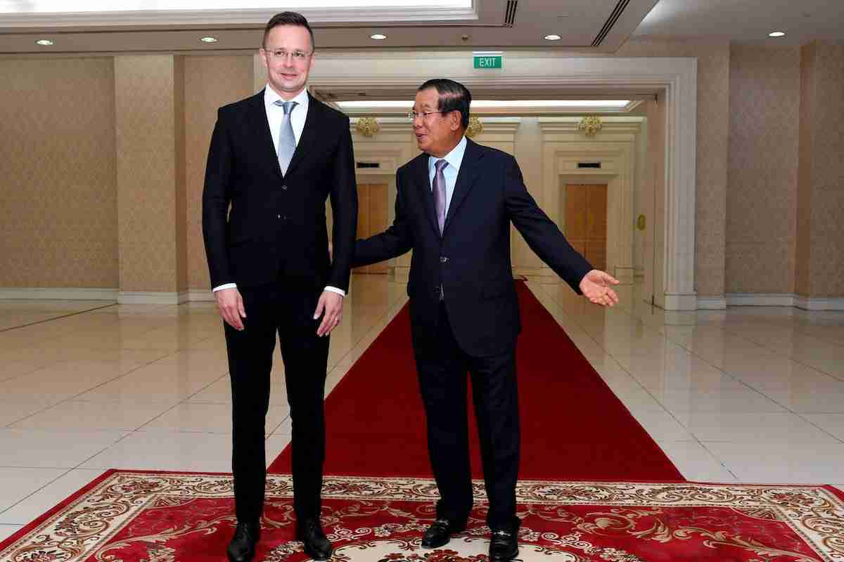 Cambodia's Prime Minister Hun Sen welcomes Hungary's Foreign Minister Peter Szijjarto during a meeting at the Peace Palace in Phnom Penh. - Hungary's foreign minister tested positive to coronavirus in Thailand.