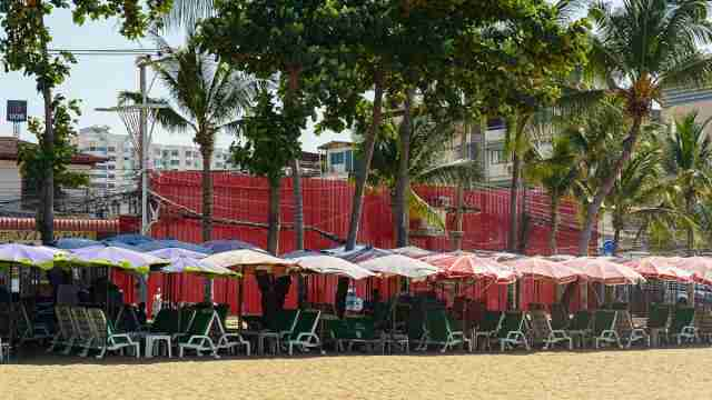 Empty beach chairs span the length of Pattaya Beach Nov. 14, 2020 as the city struggles from a lack of international tourists.