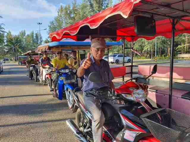 "Phuket villagers are ready to drive tourists around in their modified motorcycles as part of a community-based tourism package, including a stop at Mai Khao Beach where visitors can observe aircraft landings. The roofed sidecar motorcycles known as ""saleng"" are owned by villagers in the Ban Mai Khao Community in Phuket. They say it's a fun form of travel and easy way to visit the famous Mai Khao Beach. The beach is located just off Phuket International Airport's runway and provides a perfect spot for plane-spotters to snap photos of aircraft on their approach to the airport. Ban Mai Khao's Vice President of Tourism Manit Saithong said Thursday that community anticipates visitors will soon be back as the Covid-19 situation has greatly de-escalated. These saleng taxis will transport visitors to and from Mai Khao Beach, as well as other community-based tourism attractions, such as the last rice farm on Phuket, a buffalo farm, or a Cicadidae-catching activity. Visitors can book these activities at the Saleng Taxi stand in Phuket."