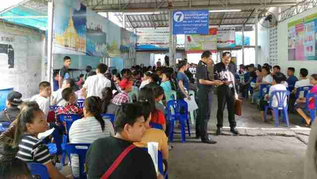 Migrant workers wait in immigration queues in Samut Sakhon Thailand.