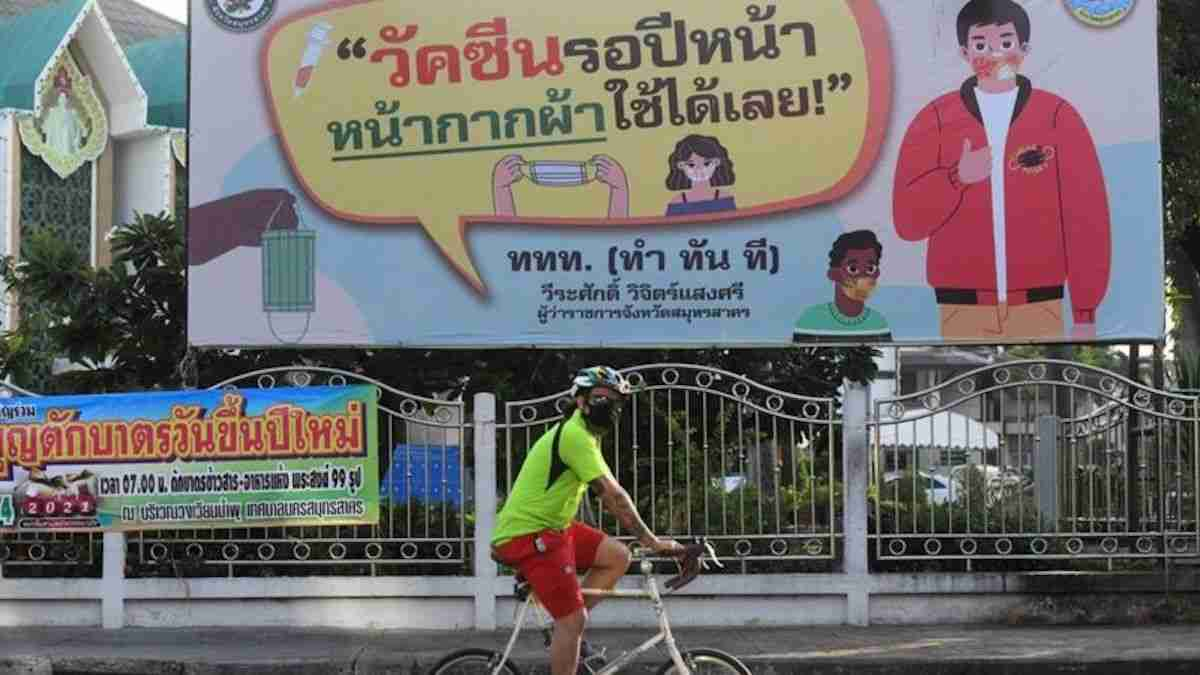 A cyclist rides through Muang District of Rayong, which is under virtual lockdown.