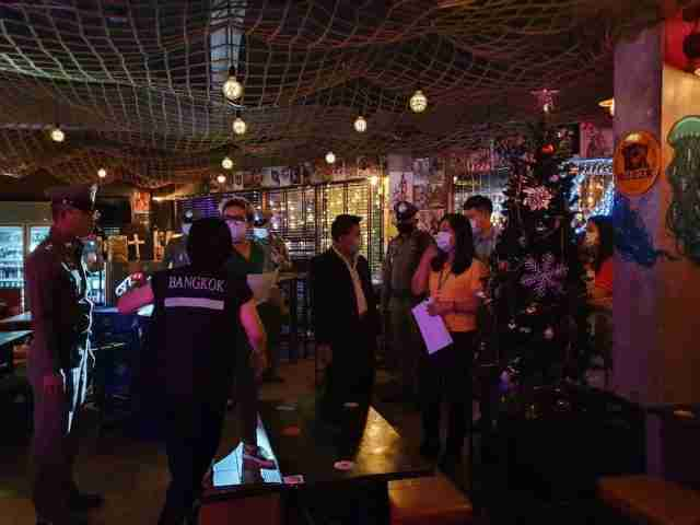 Bangkok officials presented shutdown orders to pub and bar owners Friday night.