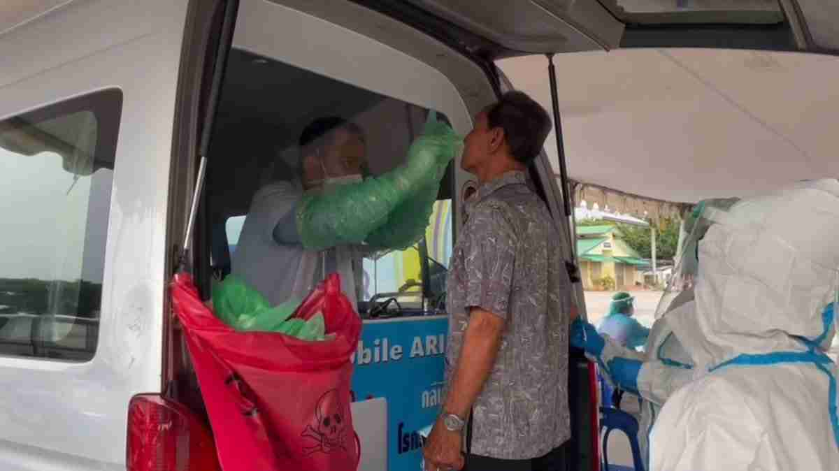 A patient is screened at a hospital in Rayong.