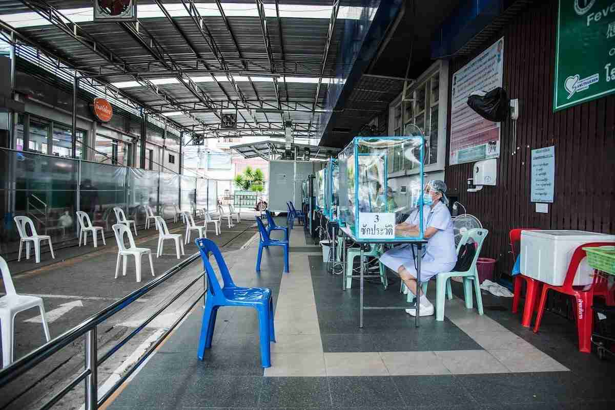 A photo from the Samut Sakhon Provincial Public Health Office shows nurses waiting for the arrival of migrant laborers taking coronavirus tests.
