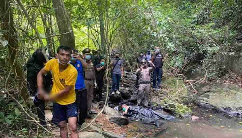 Police take suspect Teerawat Thothip to Ton Ao Yon waterfall in Phuket where he allegedly killed a Swiss tourist. It was part of a crime re-enactment on Sunday.