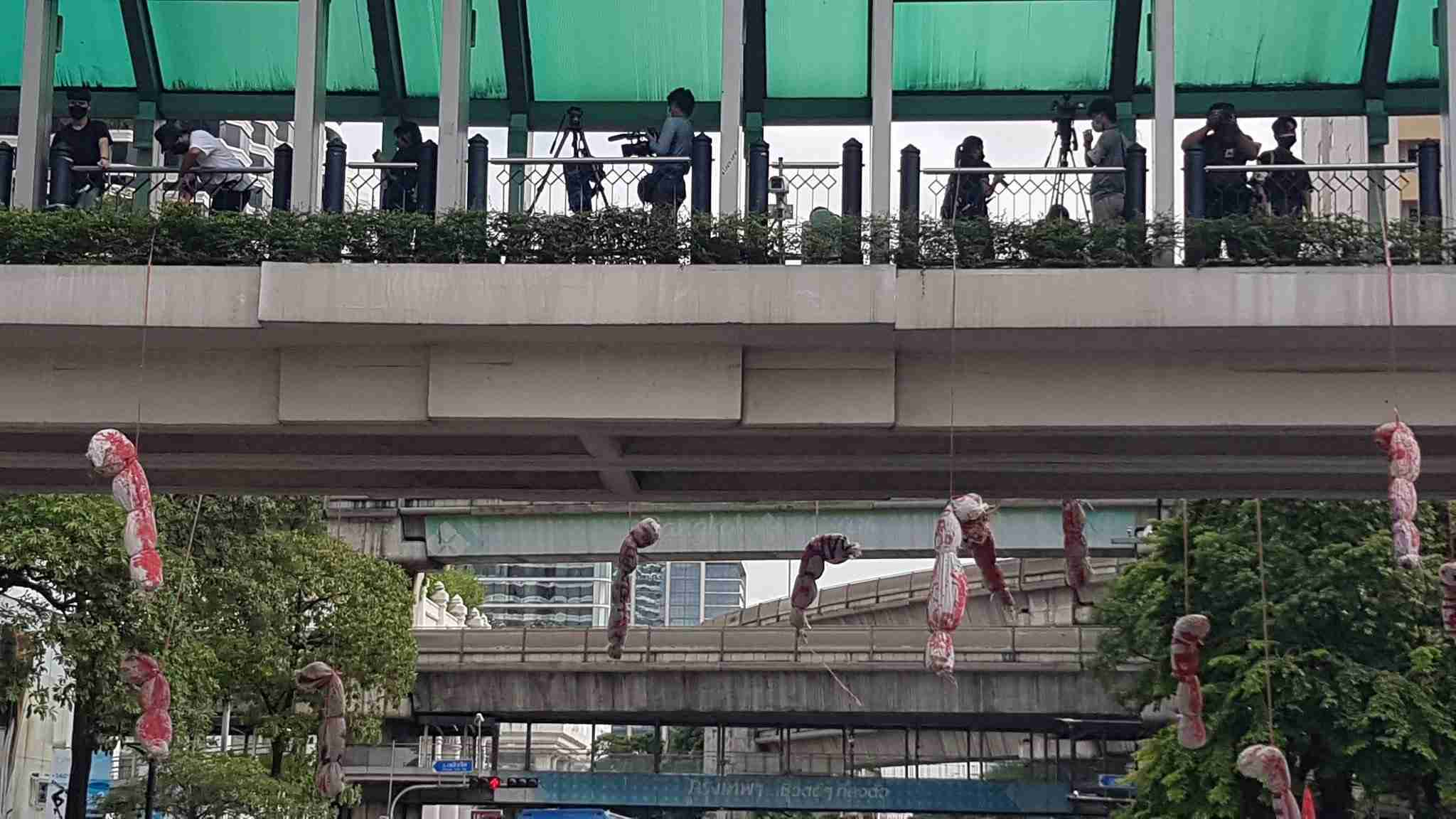 During a rally at the Ratchaprasong intersection in central Bangkok on Sept. 3, protesters hung mock cadavers in body bags from a pedestrian bridge as a reminder of the thousands of deaths in the country due to an ongoing Covid-19 outbreak.